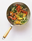 Cabbage with pepper, pineapple, sprouts and sesame in a wok