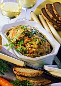 Pate with carrots & mushrooms in rectangular dish; bread, wine