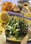 Green beans with lemon sauce and herbs on plate