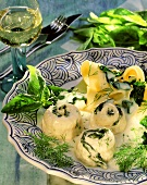 Fish rolls with herb sauce, spinach and ribbon noodles