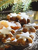 Cinnamon stars with glacé icing, dried apricots & sugar