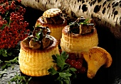 Venison goulash on puff pastry; Chanterelles; Berries