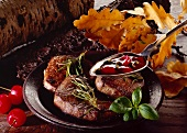 Venison medallions with spicy cherry sauce