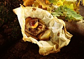 Venison fillet with apples and spices, baked in paper