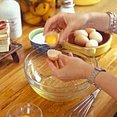 Separating eggs over a dish