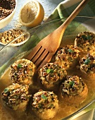 Mushrooms stuffed with cottage cheese & linseed in baking dish