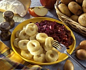 Polish potato noodle rings with red cabbage & apple salad