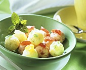 Pineapple sweets with candied fruit in green bowl