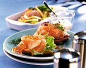 Marinated salmon trout fillet with keta caviare on white bread