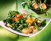 Wild herb salad with fried ceps and edible flowers