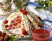 Strawberry rice bombe with cream and chopped pistachios