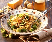 Cheese noodles (spaetzle) with Brussels sprouts on plate