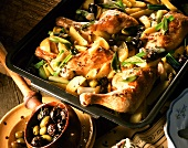 Chicken with herbs and olives, with spring onions