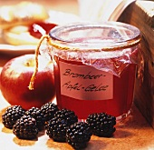 Blackberry and apple jelly in a jar, with fresh fruit
