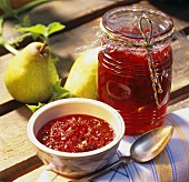 Cranberry and pear jam with cardamom in jar and dish