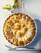 Apple pie, sprinkled with sugar, in pie dish