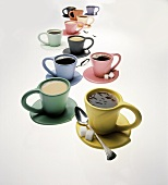 Coffee in several colourful cups
