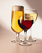 Light beer, red wine and white wine in glasses