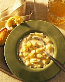 Cream soup with pilgrim scallops and bread