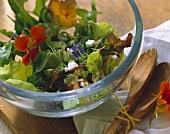 Summer salad: sheep's cheese & edible flowers; salad servers