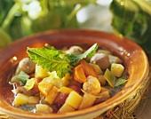 Kohlrabi stew with sausage dumplings on brown plate