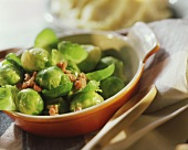 Brussels sprouts with bacon in a gratin dish; mashed potato