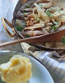 Braised kidneys in round pan; mashed potato
