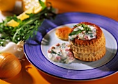 Ham ragout in puff pastry with rocket