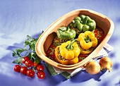 Stuffed peppers with tomato sauce in a Römertopf
