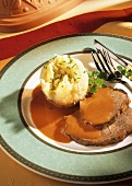 Roast beef in red wine with potato dumpling