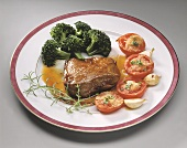 Rack of lamb with tomatoes and broccoli