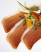 Three slices of Parma ham, garnished with vegetables
