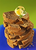 A pile of green rye bread slices