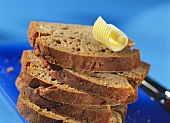 Slices of caraway and beer bread in a pile