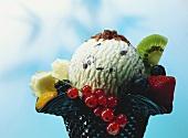 Chocolate chip ice cream (stracciatella) with fresh fruit