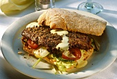 Ciabatta sandwich with beef steak and thyme mayonnaise