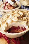 Raspberry pudding with meringue topping in baking dish