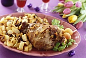 Leg of lam with roast potatoes and apricots