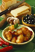 Fried potatoes with chili; olives, cheese