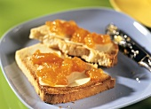 White sandwich bread with butter and apricot jam