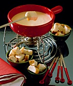 Swiss cheese fondue with white bread cubes
