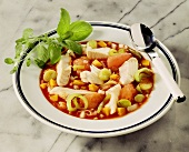 Fish stew with tomatoes and leeks on plate