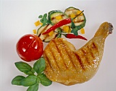Barbecued chicken leg with vegetables and herbs