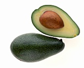 Whole and half avocado with stone