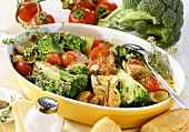 Broccoli gratin with tomatoes and onions