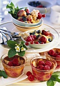 Small raspberry puddings and berries with port zabaione