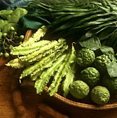 Asparagus peas and kafir limes in a basket