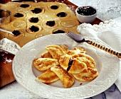 Plum pasties (Powidltascherl) with breadcrumbs & icing sugar