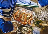 Shrimps & fish with food wrap, grill pan & plastic containers