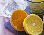 Orange & grapefruit halves, lemon squeezer & measuring jug